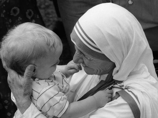 Mother Teresa, the 1979 Nobel Peace Prize laureate, came to Kentucky to oversee the opening of the first rural mission in the USA for the Missionaries of Charity.  Located in the Appalachian community of Jenkins, KY, the St. George Catholic church held two masses on successive days, June 18 and 19, 1982 to honor her and officially open the mission.On June 21 and 22, Mother Teresa came to Louisville, KY to receive the Bellarmine Medal, the highest honor from Bellarmine College.  She held a small press conference the spoke to the crowd of 4,000 who waited hours to hear her.Mother Teresa holds a small child following a Mass at the St. George Catholic church in Jenkins, KY.