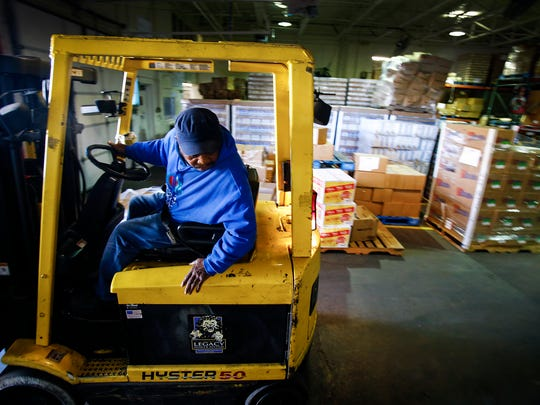 Mid-South Food Bank forklift operator Fred Jones grabs