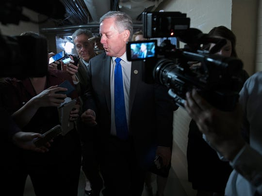 Rep. Mark Meadows, R-N.C., chairman of the House Freedom Caucus, answers questions while leaving a meeting of the House Republican caucus at the U.S. Capitol on April 26, 2017.