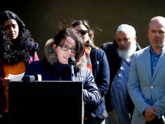Melisa Valdez (left) partner of Manuel Duran, reads a letter penned by him from a immigration detention center in Louisiana, during a press conference April 16.