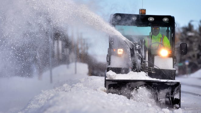 Kelly Cape of the city's of Public Works Department clears snow along Fox Farm Road.