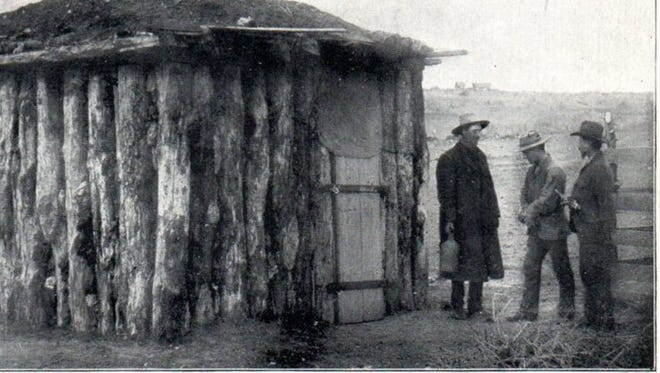 The first jail in San Angelo, as seen in this photo by pioneer photographer M.C. Ragsdale, was a log stockade with a sod roof, built in 1875.