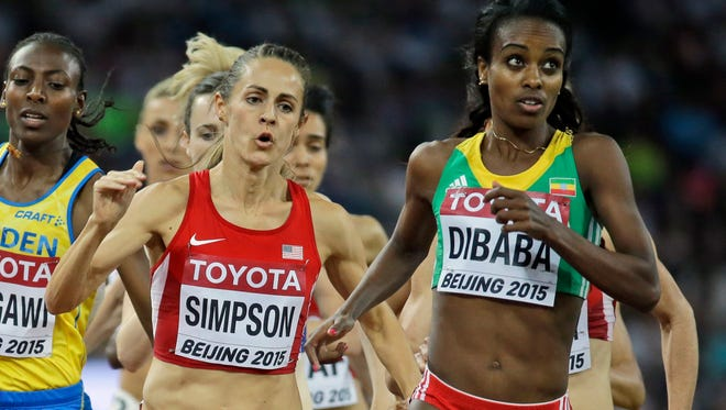 United States' Jennifer Simpson, left, and Ethiopia's Genzebe Dibaba compete in the women's 1500m final at the World Athletics Championships at the Bird's Nest stadium in Beijing, Tuesday, Aug. 25, 2015.