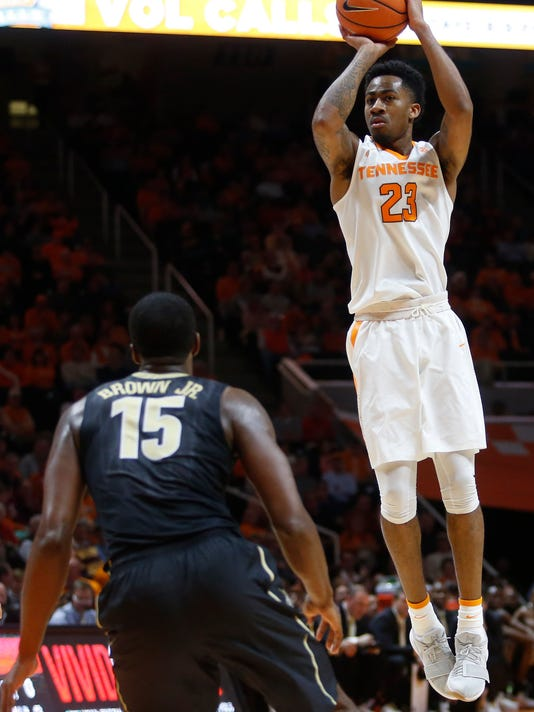 Tennessee guard Jordan Bowden (23) goes up for a basket in front of Vanderbilt forward Clevon Brown (15) in the second half of an NCAA college basketball game Tuesday, Jan. 23, 2018, in Knoxville, Tenn. (AP Photo/Crystal LoGiudice)