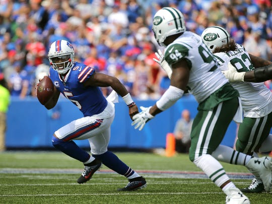 Bills quarterback Tyrod Taylor is chased out of the pocket.