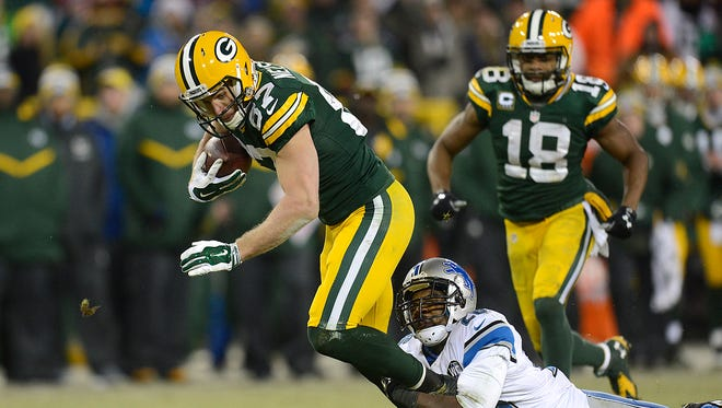 Green Bay Packers receiver Jordy Nelson (87) fights for extra yards while being tackled by Detroit Lions safety Don Carey (26) after making a catch in the fourth quarter during Sunday's game at Lambeau Field.