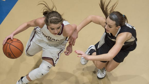 Southern Fulton's Celina Merchant, left, looks for a lane around Homer-Center's Morgan Buggey on Saturday. Merchant and the Indians lost in the first round of the PIAA tournament to end their season.