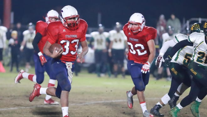 Strathmore's Joseph Garcia (33) rushes against Sierra Pacific in Friday's Central Section Division VI championship football game. The Spartans won 46-20.