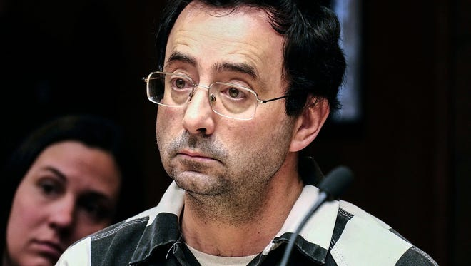 Larry Nassar listens to testimony of a witness during a preliminary hearing, in Lansing, Mich., on Feb. 17, 2017. The former Michigan State University and USA Gymnastics doctor is accused of molesting girls at his home and a campus clinic.