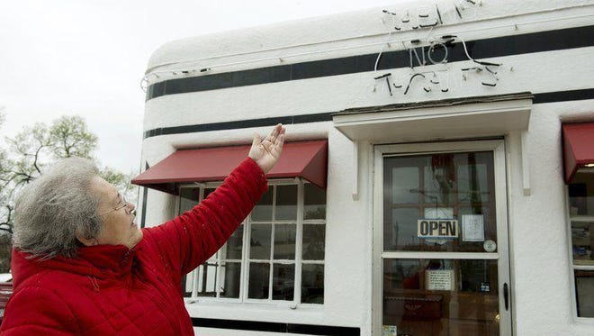 Deborah Harvey talks about the neon light replacement at the Boots Motel in Carthage on April 7, 2016.