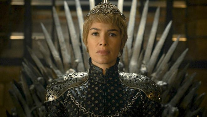 """In this image released by HBO, Lena Headey appears in a scene from """"Game of Thrones.""""  """"Game of Thrones"""" and """"Veep"""" are among the top contenders for the 68th prime-time Emmy Award nominations. The shows claimed the top drama and comedy series prizes at last year's Emmy ceremony.  (HBO via AP)"""