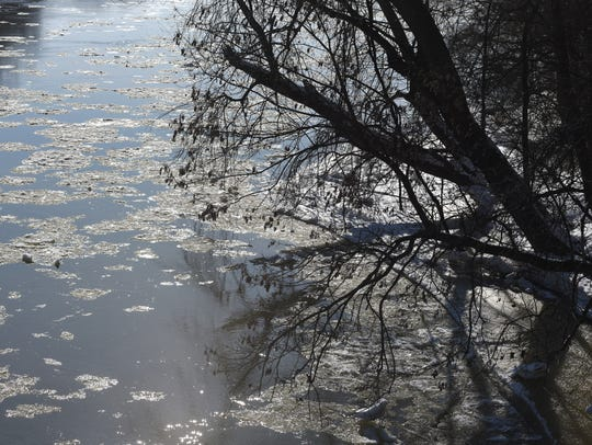 Ice chunks flow south on the Muskingum River near Coshocton