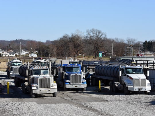 Trucks line up at Buckeye Brine in Coshocton. The injection well facility at the intersection of Airport Road and U.S. 36 opened in the fall of 2012.