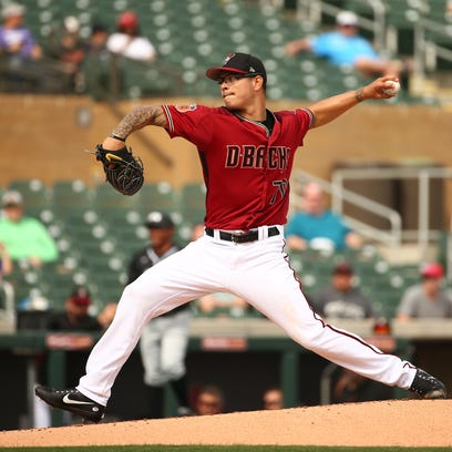 Arizona Diamondbacks pitcher Anthony Banda throws to