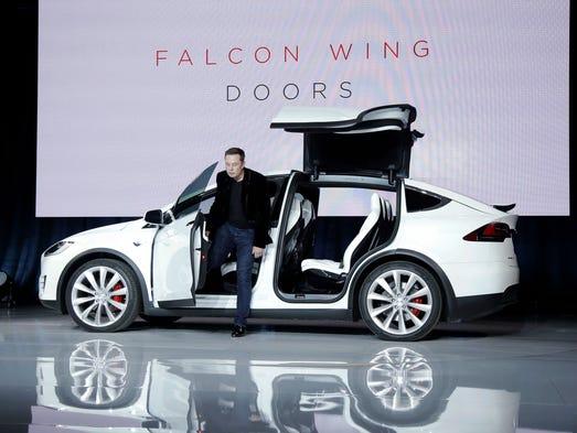 Tesla prices novel model x suv at 80 000 for Tesla model x porte