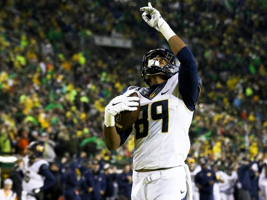 California tight end Stephen Anderson (89) points to the sky after scoring a touchdown during the first half of an NCAA college football game against Oregon, Saturday, Nov. 7, 2015, in Eugene, Ore. (AP Photo/Ryan Kang)