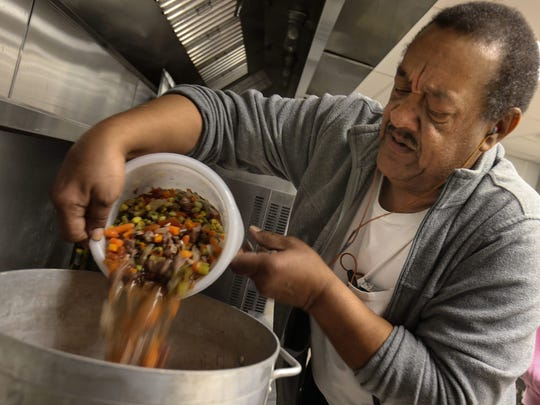 Friendship House transitional housing program director John Owens heats up beef and vegetable soup to serve to those seeking refuge from the cold during a Code Purple night in Wilmington. In Middletown, Our Daily Bread will provide the hot meals for those who seek shelter on Code Purple nights. Middletown's effort is modeled after that of Friendship House.