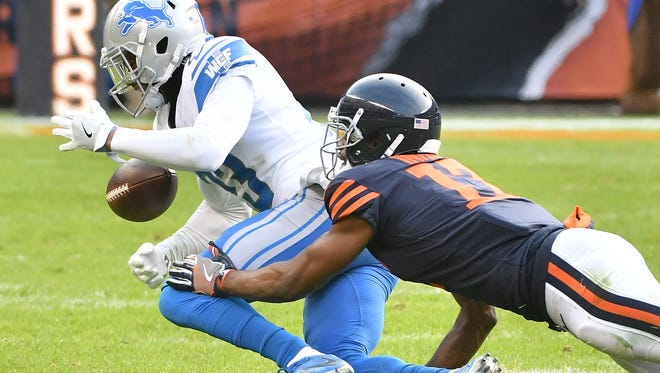 Lions' Darius Slay just misses intercepting a pass intended for Bears' Dontrelle Inman on Chicago's last offensive drive late in the fourth quarter.