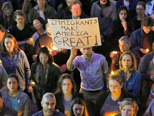 Hundreds protest Trump travel ban at Dallas vigil