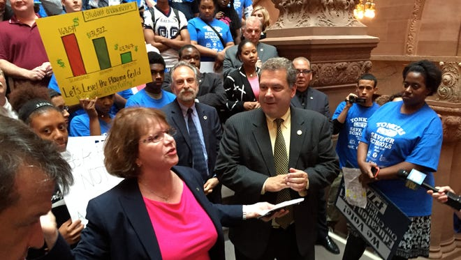 Yonkers Teachers Union President Pat Puleo with Yonkers Mayor Mike Spano at a rally in Albany to push for the state Legislature to increase state aid to the school district as it faces layoffs and program cuts.