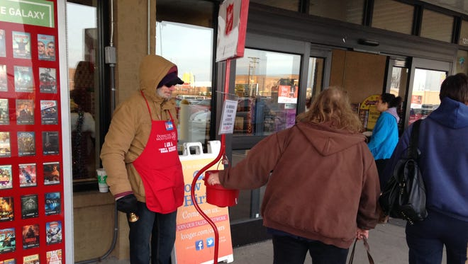 Bell ringer Port Huron resident Hal Gerhold thanks a few people for donating money outside Kroger at 1215 24th St. in Port Huron on Monday.