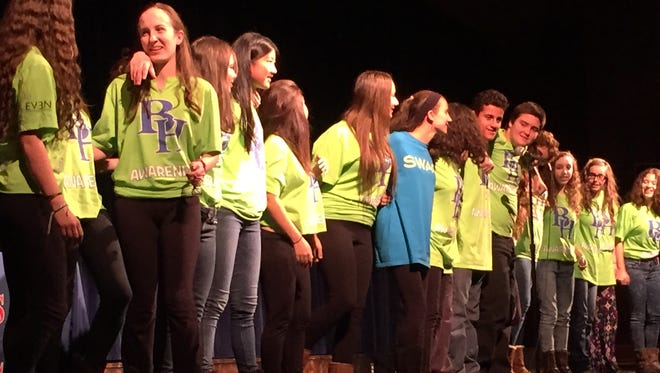 """Byram Hills High School students sing """"Lean on Me"""" at a program Thursday about identifying student depression."""