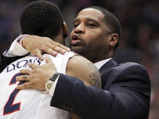 Arizona assistant coach Book Richardson hugs Arizona