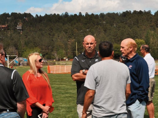 Director of Sales and Marketing at The Lodge at Sierra Blanca Katie Kmetz hosts a tour of the football fields the Village of Ruidoso Sports Complex. The UTEP Miners football team will use the facilities for its pre-season camp in Aug.
