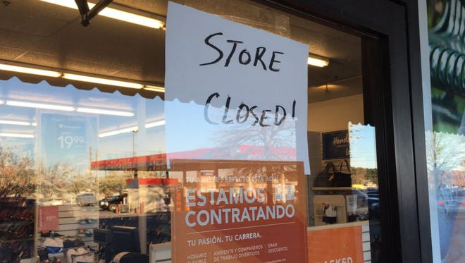 A Payless ShoeSource store in Riverdale, Ga., was closed Saturday, March 3, 2018, a day after a 2-year-old girl died after a mirror fell on her. The store was initially open when reporters arrived.