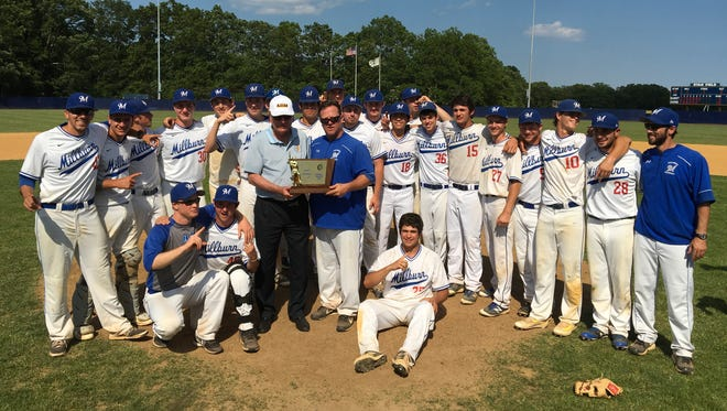 The Millburn baseball team receives the Group 4 championship for the second time in three years.