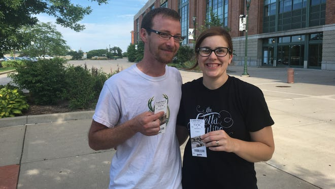 Aaron and Chelsea Shmauz bought tickets for the Milwaukee Brewers game Friday night. The team is in first place following the all-star break.