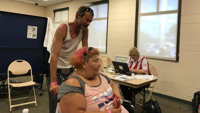 Shawn and Mary Moore, of North Fort Myers, were still at the shelter at the Estero Community Park and Recreation Center on Tuesday, Sept. 19, 2017, because their rental home is still under water. Shawn Moore said they had received a FEMA voucher  for a motel room in Clearwater.