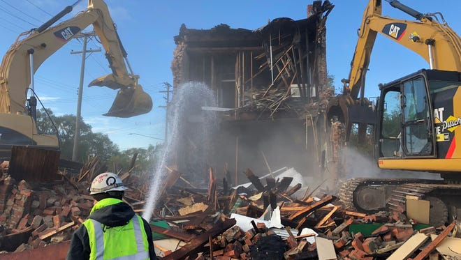 The two-story brick building that housed Kovacs Bar for most of the past century is torn down Nov. 6, 2017 to make way for the Gordie Howe International Bridge construction in the Delray neighborhood in southwest Detroit.
