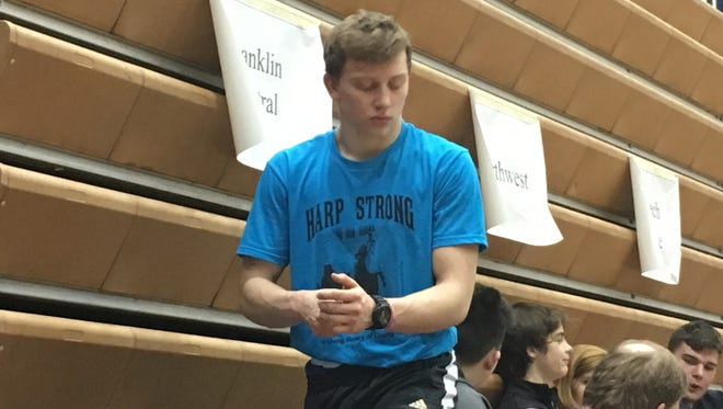"Franklin Central's Chase Peavler wears a ""Harp Strong"" shirt remembering freshman wrestler Charlie Harp, who died last week."