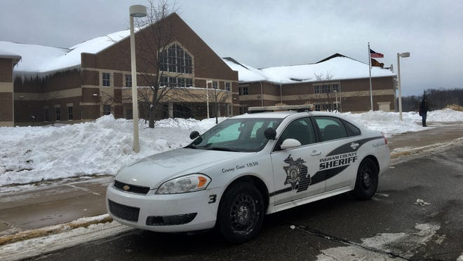 An Ingham County Sheriff's office car is parked outside of Holt High School Tuesday, Feb 13.