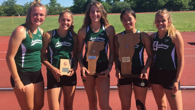The St. Johnsbury girls pose with their trophies after Tuesday's high school decathlon state championships.