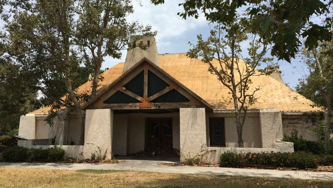 Roof tiles have been removed from the former Black Angus restaurant building in Thousand Oaks, raising questions about its future.