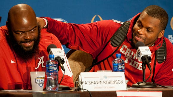Alabama's A'Shawn Robinson, left, and Reggie Ragland joke with each other during a press conference for the Cotton Bowl on Monday December 28, 2015 in Dallas, Tx.