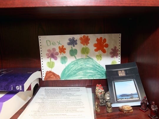 Judge Leila Mills' mementos are in a shelf in her office.