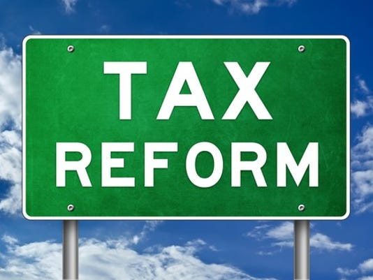 tax-reform-road-sign_gettyimages-843846618_large.jpg