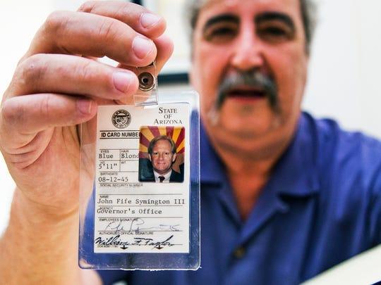 Arizona Capitol Museum Historian Jack August holds