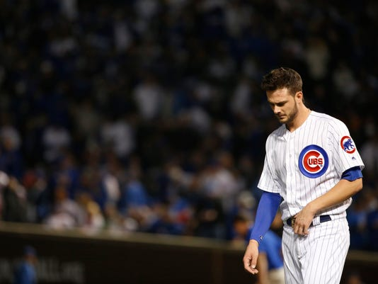 Chicago Cubs' Kris Bryant (17) walks back to the dugout at the end of the third inning of Game 4 of the Major League Baseball World Series against the Cleveland Indians, Saturday, Oct. 29, 2016, in Chicago. (AP Photo/Nam Y. Huh)