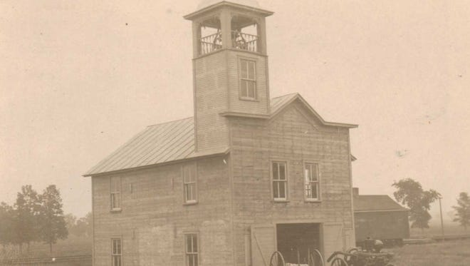 Collins fire station in 1909 with hose cart in front.