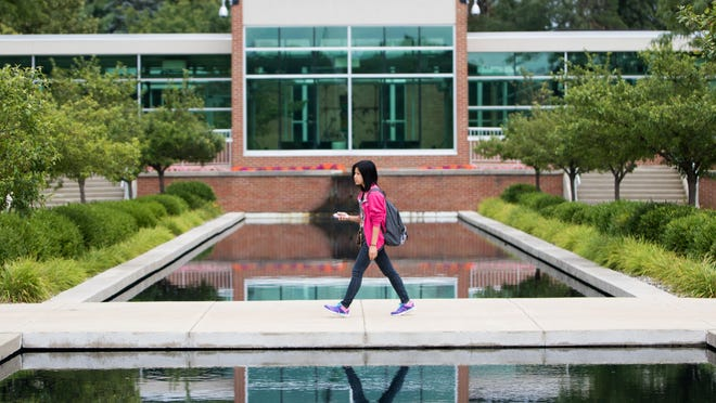 A student walks on campus during Kellogg Community College's first day of classes.