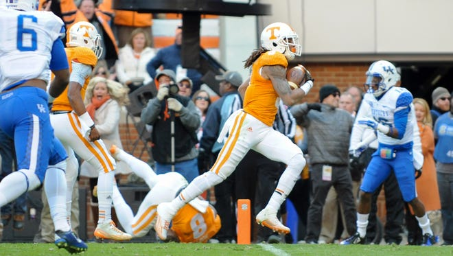 Nov 15, 2014; Knoxville, TN, USA; Tennessee Volunteers wide receiver Von Pearson (9) runs for a touchdown against the Kentucky Wildcats during the first quarter at Neyland Stadium. Mandatory Credit: Randy Sartin-USA TODAY Sports