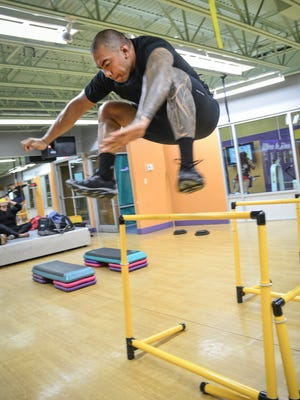 Instructor Ray Chargualaf demonstrates a jumping exercise at his Performance Program class at Paradise Fitness Center in Hagåtña on April 19.