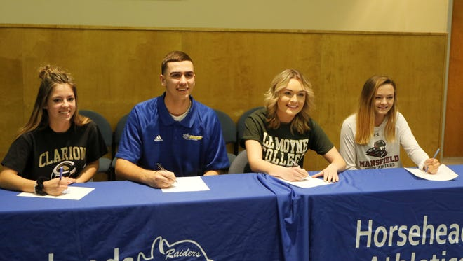 Horseheads High School seniors, from left, Kaylin Quanz, Nate VanBrunt, Emily Cunningham and Lacey O'Donnell sign Letters of Intent on Wednesday afternoon during a ceremony at the high school.