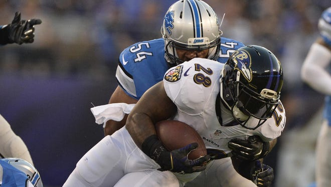 Lions linebacker DeAndre Levy tackles Ravens running back Terrance West in a preseason game. Levy is not expected to play Sunday vs. the Eagles.