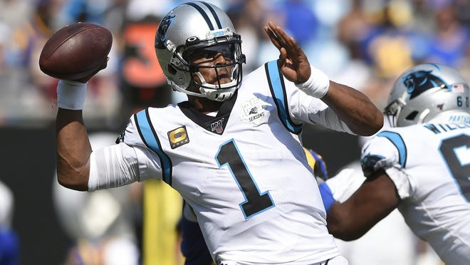 In this Sept. 9, 2019, file photo, Carolina Panthers quarterback Cam Newton looks for a receiver during a game against the Los Angeles Rams in Charlotte, N.C. The New England Patriots have reached an agreement with free-agent quarterback Newton, bringing in the 2015 NFL Most Valuable Player to help the team move on from three-time MVP Tom Brady.