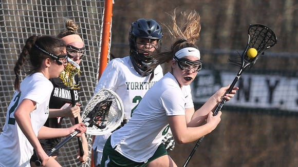 Yorktown defeated Mamaroneck 7-6 in girls lacrosse action at Yorktown High School April 13, 2018.